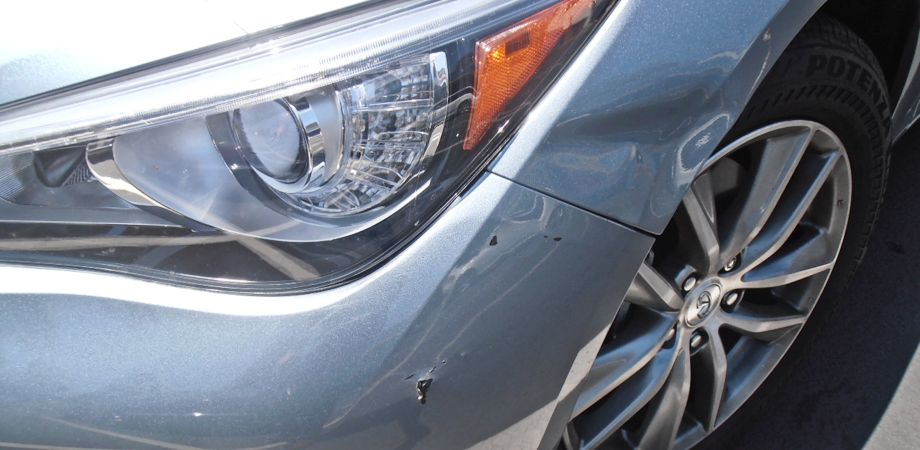 2014 Infiniti Q50 L/Front Bumper & Fender Damage: $1750. Both damaged panels were repaired which minimized the area that had to be repainted.