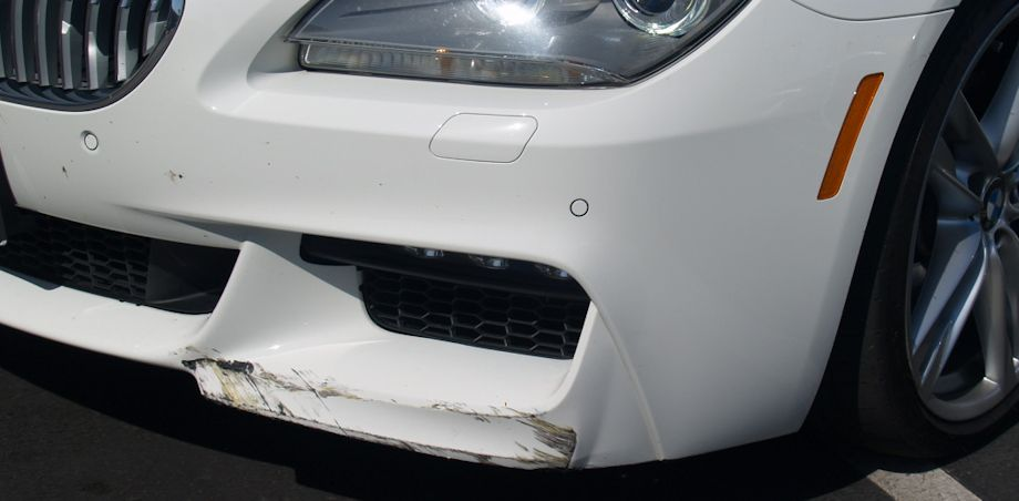 This Pearl White 2013 BMW 650i looks like a simple bumper scuff, but it's not. She had some internal damage and a bent rim...
