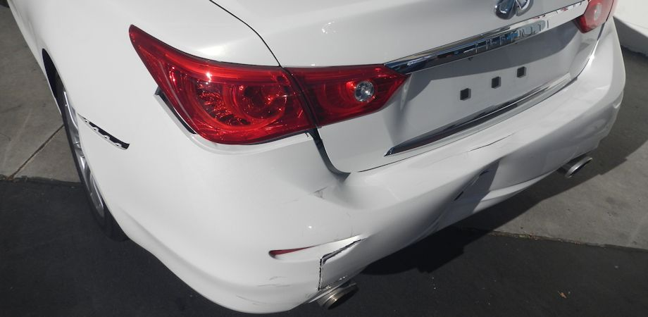 No plates yet! This pretty Pearl White 2014 Infiniti Q50 got sandwiched. It was hit from behind...